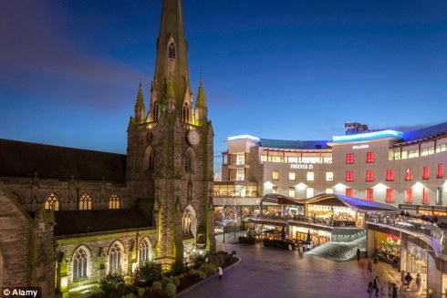 The Bullring Shopping Centre creates activity in the public plaza and celebrates the city's landmark historic church.